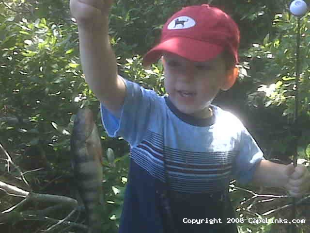 a boy's first fish
