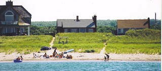 View of home from a boat out in the Bay waterfront-home-at-east-sandwich-beach_sanddollar
